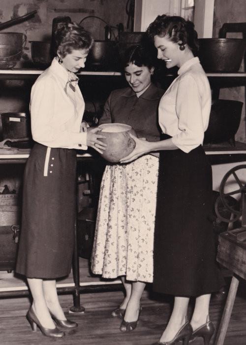 Museum volunteers examining artifacts